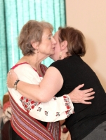 Myrna-Kostash-receives-sash-from-Sharon-Morin